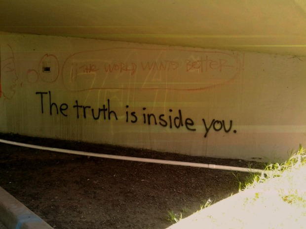 "graffiti on a run, ""the truth is inside you"""